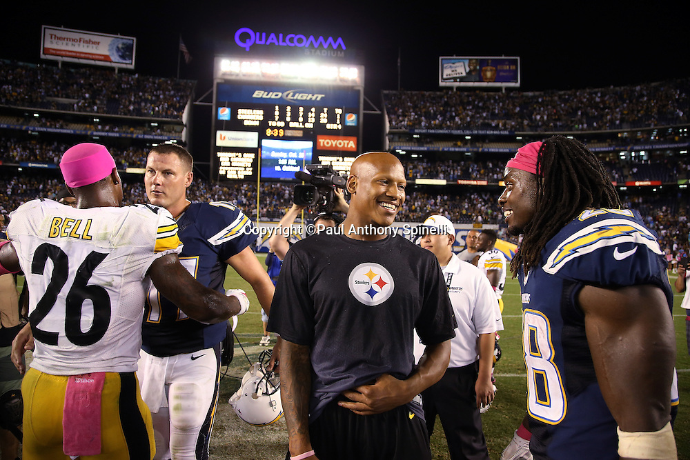 San Diego Chargers quarterback Philip Rivers (17) congratulates Pittsburgh Steelers running back Le'Veon Bell (26) as Pittsburgh Steelers inside linebacker Ryan Shazier (50) (black shirt) talks to San Diego Chargers running back Melvin Gordon (28) after the 2015 NFL week 5 regular season football game against the San Diego Chargers on Monday, Oct. 12, 2015 in San Diego. The Steelers won the game 24-20. (©Paul Anthony Spinelli)