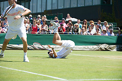 LONDON, ENGLAND - Monday, June 28, 2010: Bob Bryan (USA) takes a tumble during the Gentlemen's Doubles 2nd Round match on day seven of the Wimbledon Lawn Tennis Championships at the All England Lawn Tennis and Croquet Club. (Pic by David Rawcliffe/Propaganda)