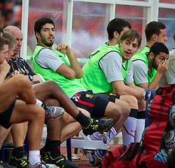 BANGKOK, THAILAND - Sunday, July 28, 2013: Liverpool's substitute Luis Suarez sits on the bench during a preseason friendly match against Thailand XI at the Rajamangala National Stadium. (Pic by David Rawcliffe/Propaganda)