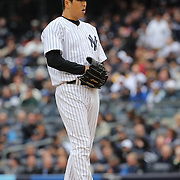 Hiroki Kuroda, New York Yankees, pitching during the New York Yankees V Baltimore Orioles home opening day at Yankee Stadium, The Bronx, New York. 7th April 2014. Photo Tim Clayton