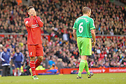 Liverpool midfielder Roberto Firmino  can't believe he's missed  during the Barclays Premier League match between Liverpool and Sunderland at Anfield, Liverpool, England on 6 February 2016. Photo by Simon Davies.