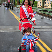 BRUNSWICK, Maine -- 5/30/16 -- Mikell Reed Carroll, Mrs. Maine, and her son, Danny,  of Portland, participated in the Memorial Day parade on Monday. The Memorial Day Parade and ceremonies in Brunswick and Topsham went off as planned following a few light showers in the early morning. Many of the other regional parades were cancelled due to expected bad weather. Photo by Roger S. Duncan for The Forecaster