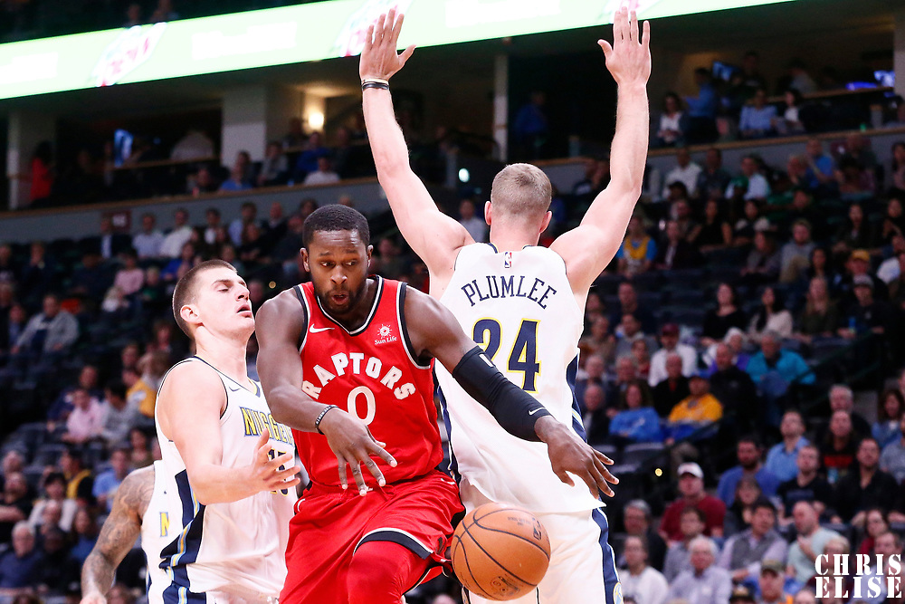 01 November 2017: Toronto Raptors forward CJ Miles (0) passes the ball past Denver Nuggets center Mason Plumlee (24) and Denver Nuggets center Nikola Jokic (15) during the Denver Nuggets 129-111 victory over the Toronto Raptors, at the Pepsi Center, Denver, Colorado, USA.