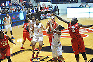 "Georgia Bulldogs forward Krista Donald (15) blocks a shot by Mississippi Lady Rebels guard Erika Sisk (5) at the C.M. ""Tad"" Smith Coliseum in Oxford, Miss. on Thursday, January 15, 2015.  (AP Photo/Oxford Eagle, Bruce Newman)"