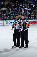 KELOWNA, CANADA - FEBRUARY 15:  Referees Jeff Ingram and Nick Panter stand on the ice at the Kelowna Rockets against the Everett Silvertips on February 15, 2019 at Prospera Place in Kelowna, British Columbia, Canada.  (Photo by Marissa Baecker/Shoot the Breeze)