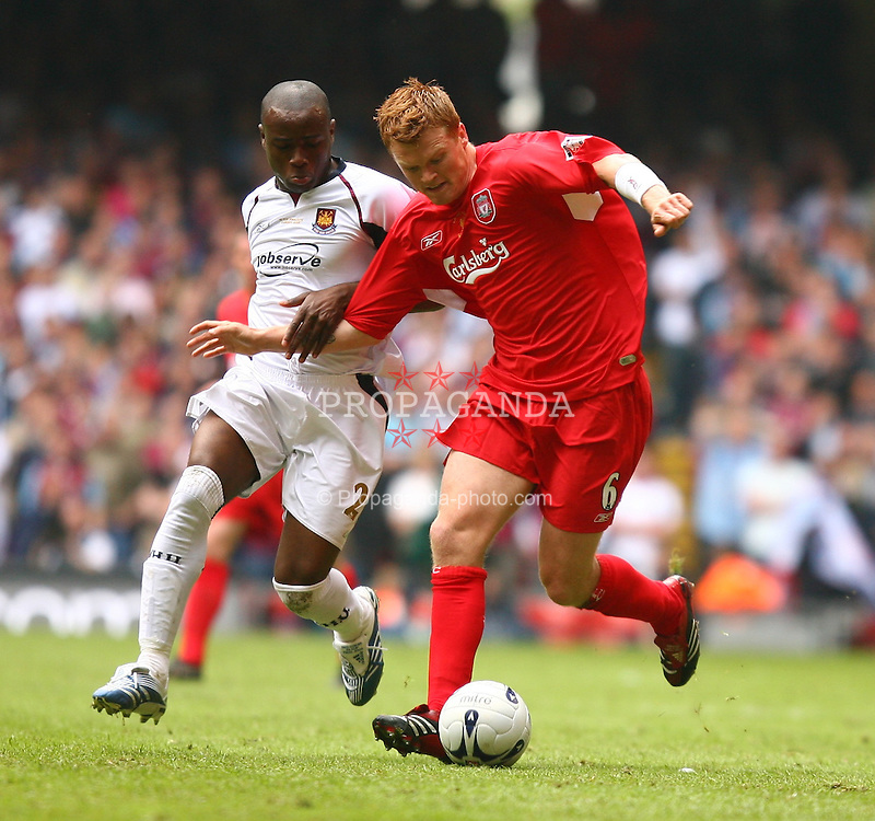 CARDIFF, WALES - SATURDAY, MAY 13th, 2006: Liverpool's John Arne Riise and West Ham United's Nigel Reo-Coker during the FA Cup Final at the Millennium Stadium. (Pic by David Rawcliffe/Propaganda)