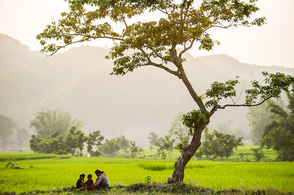 A very beautiful scene of mother and kids having a beautiful moment together. This picturesque image was made on my drive through Pokhara. <br />