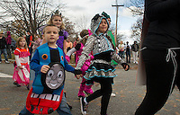 Pleasant Street School takes over the streets of Laconia Wednesday afternoon for their annual Halloween Parade.  (Karen Bobotas/for the Laconia Daily Sun)
