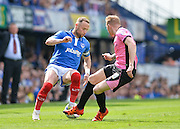 Portsmouth defender Ben Davies takes on Northampton Town Midfielder Nicky Adams during the Sky Bet League 2 match between Portsmouth and Northampton Town at Fratton Park, Portsmouth, England on 7 May 2016. Photo by Adam Rivers.