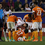 Tim Cahill, New York Red Bulls, checks on the wellbeing of  Boniek García, Houston Dynamo, after Cahill was sent off for reckless challenge during the New York Red Bulls Vs Houston Dynamo, Major League Soccer regular season match at Red Bull Arena, Harrison, New Jersey. USA. 4th October 2014. Photo Tim Clayton