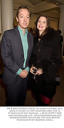 MR & MRS GEORDIE GREIG, he is editor of Tatler, at a party in London on 30th November 2000.	OJS 12