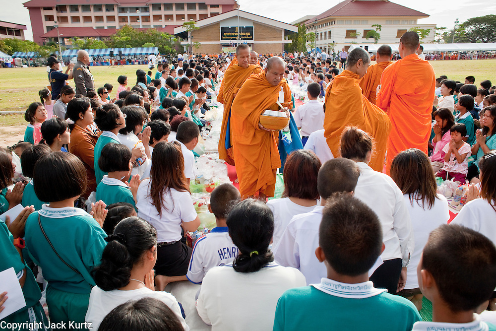 "Sept. 26, 2009 -- PATTANI, THAILAND:  Buddhist monks walk through the crowd accepting donations of food during the Tak Bat Sankatan ceremony in Pattani, Thailand Saturday. Buddhists in Thailand's three southern most provinces gathered in Pattani Saturday, Sept 26 to celebrate Tak Bat Sankatan, the day Lord Buddha returned to earth and was greeted by a crawd of his disciples and Buddhist believers who were waiting to offer him food. Buddhists monks representing the 266 ""Wats"" (temples) in the three provinces (Pattani, Narathiwat and Yala) processed through the crowd and were presented with food and gifts.   Photo by Jack Kurtz"