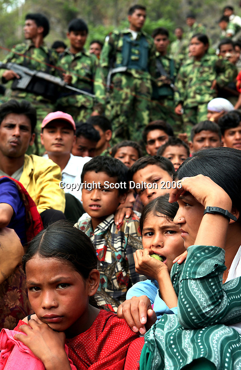 Local residents attend a Maoist rebel gathering in a remote part of western Nepal on June 22, 2006. The ten-year old conflict in Nepal has claimed an estimated 13,000 lives. (Photo/Scott Dalton)