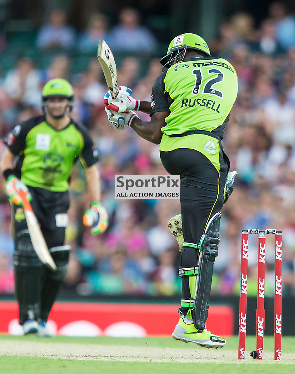 KFC Big Bash League T20 2015-16 , Sydney Sixers v Sydney Thunder, SCG; 16 January 2016<br /> Sydney Thunder Andre Russell jumps in the air for another 4