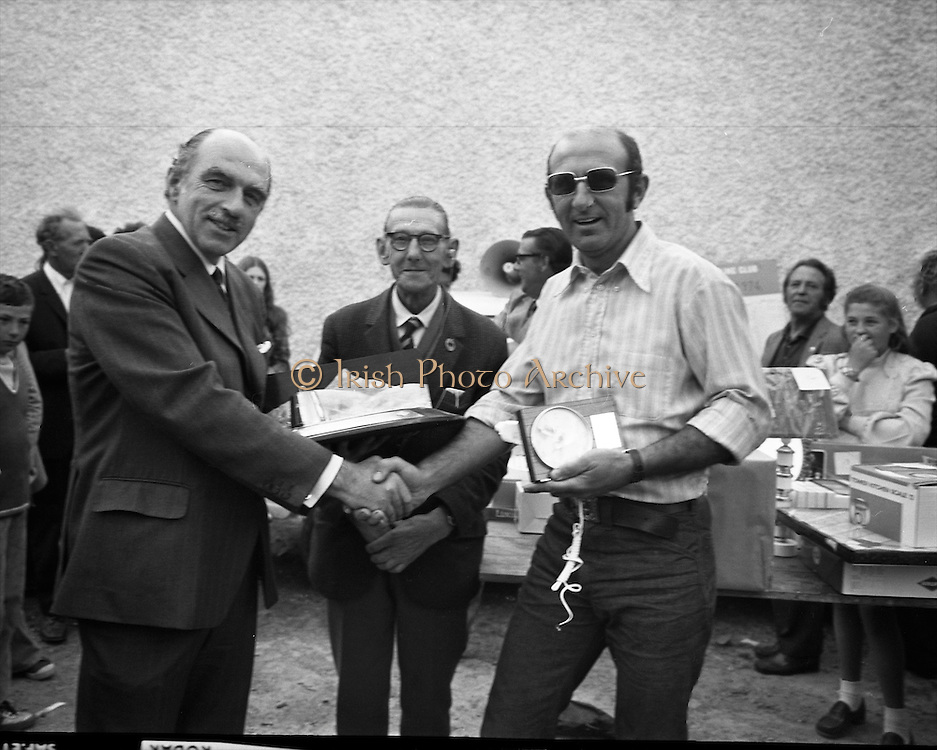 Knights of the Silver Hook.  (H1)..1974..30.06.1974..06.30.1974..30th June 1974..The Knights of the Silver Hook sea angling competition took place off Greystones today. the competition was sponsored by Player Wills Ireland Ltd.The competition was organised by The Silver Hook Club,Greystones, Co Wicklow..Picture shows Mr Cecil Weldon,Area Manager,Player Wills,Irl,Ltd,presenting Mr P Duffy, Poolbeg sea angling club, Dublin, with the Players No6, Trophy as overall winner. In the centre is Mr W Tyrer, President of The Knights of the Silver Hook,S.A.C.