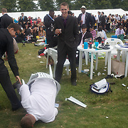 A man falls from his chair during the race meeting at Royal Ascot Race Course. Royal Ascot is one of the most famous race meetings in the world, frequented by Royalty and punters from the high end of society to the normal everyday working class. Royal Ascot 2009, Ascot, UK, on Friday, June 19, 2009. Photo Tim Clayton.