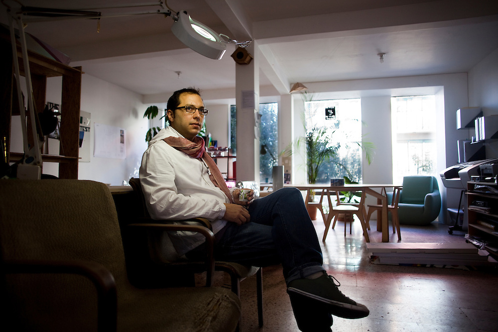 Emiliano Godoy sits in his office in the Roma neighborhood of Mexico City.