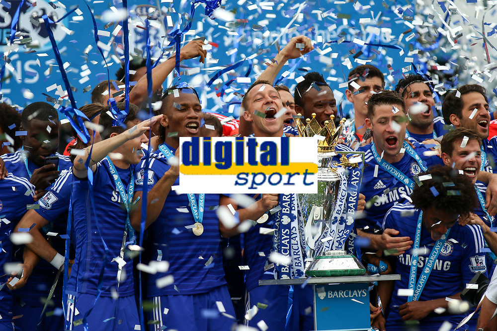 Football - 2014 / 2015 Premier League - Chelsea vs. Sunderland.   <br /> <br /> Chelsea players on the podium celebrate lifting the Premier League trophy at Stamford Bridge<br /> <br /> COLORSPORT/DANIEL BEARHAM