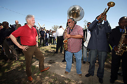 16 March 2008. New Orleans, Louisiana. Lower 9th ward.<br /> Former President Bill Clinton talks saxophones and enjoys a rousing performance by the Lucky 8 Brass Band before he leaves the area. Clinton was in town for the 'Make a Difference, Make a Commitment' clean up of the neighbourhood devastated by Hurricane Katrina. The massive clean up project was organised by Brad Pitt's Make it Right Foundation aided by the Clinton Global Initiative.<br /> Photo credit; Charlie Varley.