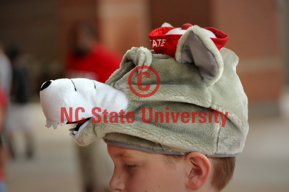 A young fan has a head for all things Wolfpack.