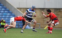 Bath's Leroy Houston pushes off the tackle from London Welsh's Seb Stegmann and takes on London Welsh's Opeti Fonua - Photo mandatory by-line: Robbie Stephenson/JMP - Mobile: 07966 386802 - 29/03/2015 - SPORT - Rugby - Oxford - Kassam Stadium - London Welsh v Bath Rugby - Aviva Premiership