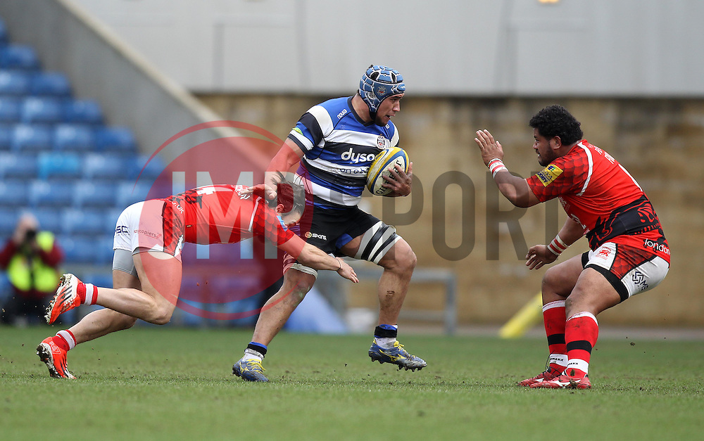 Bath's Leroy Houston pushes off the tackle from London Welsh's Seb Stegmann and takes on London Welsh's Opeti Fonua - Photo mandatory by-line: Robbie Stephenson/JMP - Mobile: 07966 386802 - 29/03/2015 - SPORT - Rugby - Oxford - Kassam Stadium - London Welsh v Bath Rugby - Aviva Premiership