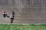 A farmer works a field on Friday morning in Hanson County. (Matt Gade / Republic)