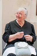 Traditional lace-making, Pag, Croatia. Teta Fani Sabalic, age 87, sits outside her house in a narrow street of Pag's old Renaissance town centre. Pag lace-making is inscribed on the UNESCO list of Intagible Cultural Heritage.