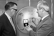 First 20p Coin..1986..29.10.1986..10.29.1986..29th October 1986..At the Central Bank's Currency Centre and Mint the Minister for Finance,Mr John Bruton,was on hand for the issue of the new 20p coin..Initially 20 million new 20p coins will be put into circulation...To commemorate the issue of the new 20p coin,The Minister for Finance,Mr John Bruton TD is presented with the first 20p coin minted.The presentation was carried out by Tomás F. Ó Cofaigh,Governor of The Central Bank