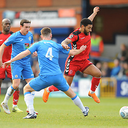 TELFORD COPYRIGHT MIKE SHERIDAN 16/2/2019 - Ellis Deeney of AFC Telford hurdles a tackle from Jordan Keane of Stockport during the Vanarama Conference North fixture between Stockport County and AFC Telford United at Edgeley Park