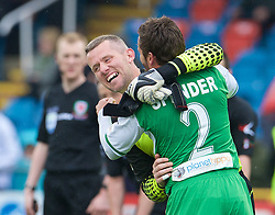 NEWTOWN, WALES - Saturday, May 2, 2015: The New Saints' captain goalkeeper Paul Harrison celebrates with team-mate Simon Spender after beating Newtown 2-0 during the FAW Welsh Cup final match at Latham Park. (Pic by Ian Cook/Propaganda)