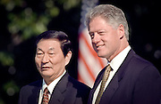 US President Bill Clinton stands with Chinese Premier Zhu Rongji during the official arrival ceremony at the White House April 8, 1999 in Washington D.C.