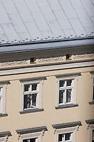 Building facade and windows on the Rynek Krakow Poland