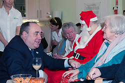 First Minister Alex Salmond, accompanied by Santa Clause (Arthur Martin), visited the Dean Club in Stiockbridge Edinburgh today to distribute Christmas presenets to the residents. The First Minister had a long chat with Rena Awramenko from Linlithgow. (c) GER HARLEY   StockPix.eu