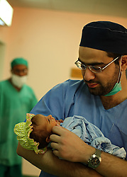 Dr. Bilal Chaudhary holds his 4-day-old patient who has not yet been named inside the Children's Hospital at the Pakistan Institute of Medical Sciences, P.I.M.S. in Islamabad, Pakistan on Sept. 18, 2007. The baby had an ambiguous gentalia with a stenused anal opening.