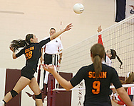 Solon's Vik Meade (28) tips the ball over the net during the WaMaC Tournament Championship game at Mount Vernon High School in Mount Vernon on Thursday October 11, 2012. Solon defeated Maquoketa 17-25, 25-15, 15-10.