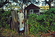 85 year old Virginia Bennet of Hilton Head South Carolina clings to the home she has occupied for 40 years, even as a multistory condominium is erected behind it.