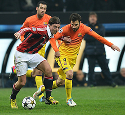 20-02-2013 VOETBAL: CHAMPIONS LEAGUE AC MILAN - FC BARCELONA: MILAAN<br /> Riccardo Montolivo Milan, Cesc Fabregas Barcellona // during the UEFA Champions League last sixteen first leg match between AC Milan and Barcelona FC at the Giuseppe Meazza Stadium<br /> ***NETHERLANDS ONLY***<br /> ©2012-FotoHoogendoorn.nl
