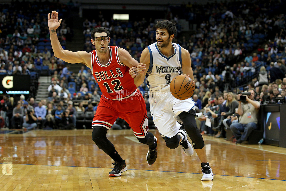 Nov 1, 2014; Minneapolis, MN, USA; Minnesota Timberwolves guard Ricky Rubio (9) drives past Chicago Bulls guard Kirk Hinrich (12) during the third quarter at Target Center. The Bulls defeated the Timberwolves 106-105. Mandatory Credit: Brace Hemmelgarn-USA TODAY Sports