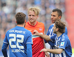 22.03.2015, Wildparkstadion, Karlsruhe, GER, 2. FBL, Karlsruher SC vs 1. FC Kaiserslautern, 26. Runde, im Bild Philipp Hofmann (1.FC Kaiserslautern) im Streit mit Enrico Valentini (Karlsruher SC) daneben Daniel Gordon (Karlsruher SC) und GaÈtan Krebs (Karlsruher SC) // during the 2nd German Bundesliga 26th round match between Karlsruher SC vs 1. FC Kaiserslautern at the Wildparkstadion in Karlsruhe, Germany on 2015/03/22. EXPA Pictures © 2015, PhotoCredit: EXPA/ Eibner-Pressefoto/ Bermel<br /> <br /> *****ATTENTION - OUT of GER*****