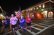 Ole Miss ROTC cadets finish the second leg of the 2nd Egg Bowl Run, in Oxford, Miss. on Monday, November 24, 2014. Mississippi State ROTC cadets ran the football to Calhoun City before handing it off to Ole Miss ROTC cadets to finish the journey.