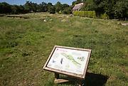 National Trust information board panel at Lockeridge Dene, near Marlborough, Wiltshire, England, UK