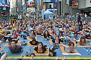 Thousands of yoga enthusiasts 'breathe happy' at the lucy Summer Solstice event presented by Febreze in the middle of New York's Times Square to find tranquility on the longest day of the year, Tuesday, June 21, 2011.  (Diane Bondareff/AP Images for Febreze)