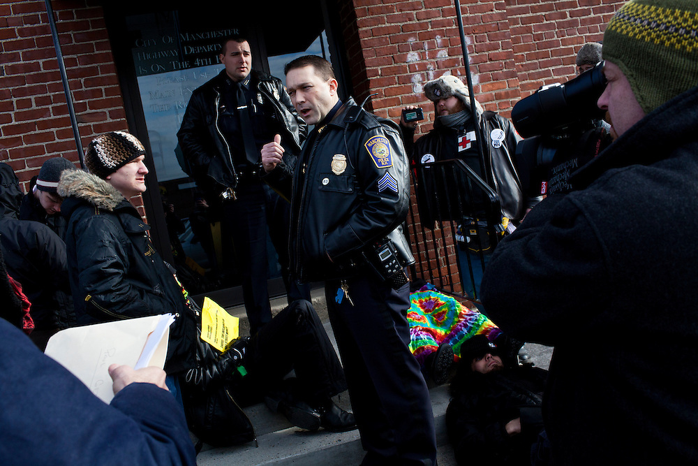 Police tell Occupy protesters to disperse after staging a die in at the offices of Organizing for America, President Obama's re-election organization, on Monday, January 9, 2012 in Manchester, NH. Brendan Hoffman for the New York Times