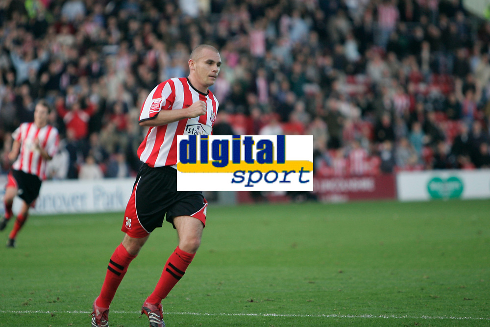 Photo: Pete Lorence.<br />Lincoln City v Rochdale United. Coca Cola League 2. 21/10/2006.<br />Jamie Forrester modestly celebrates scoring the first goal of the match.