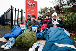 Staff at Virgin Media's Sheffield Office were sleeping rough out side their work place last night to raise awareness and funds for Shelter the Homeless charity. They were also collecting Blankets, Sleeping Bags and Clothes which will be donated to the local branch of Shelter..left to right; Danny Marshall, Will Helliwell, Jono Clegg, Laura Pattinson, Sarah Laidlores and Louise Oxley.10 November 2011. Image © Paul David Drabble