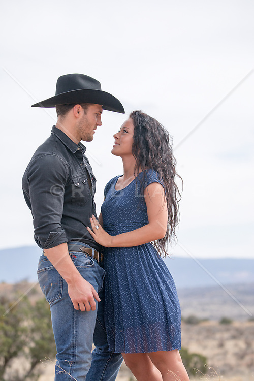 hot cowboy and a sexy girl outdoors