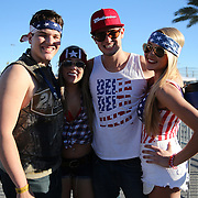 NASCAR fans pose inside the track prior to the NASCAR Sprint Unlimited Race at Daytona International Speedway on Saturday, February 15,  2014 in Daytona Beach, Florida.  (AP Photo/Alex Menendez)