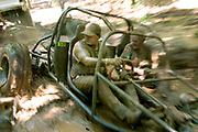Arkansas Democrat-Gazette/BENJAMIN KRAIN 8-13-04<br /> Kenneth Noisewater, from Fayetteville, steers his homemade buggy through a trench while being towed after he and passenger Lanny Guthrie, from Springdale, got the vehicle stuck in over four feet of mud during the first day of Mudstock in Cass, AR. Owners of Jeeps and other four wheel drive vehicles are competing in hill climbs, mud trench and woods courses for cash prizes this weekend at the annual event.