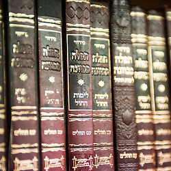 London, UK - 3 December 2014: Books are on display as Mr Stephen Williams MP, Parliamentary Under Secretary of State for Communities and Local Government, visits Talmud-Torah Yetev-Lev orthodox Jewish school in Hackney, London